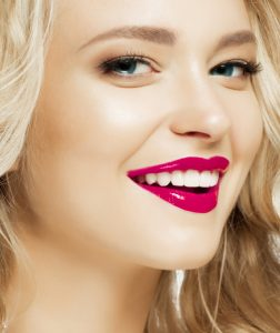 woman with a beautiful smile thanks to cosmetic dentistry services from dr dann