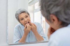 person flossing their teeth