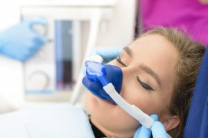 woman relaxed receiving sedation dentistry