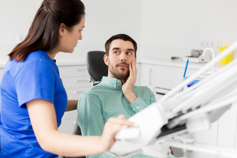 Dentist explaining relationship between sleep apnea and TMJ to patient